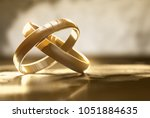 rings lay on table  3d... | Shutterstock . vector #1051884635