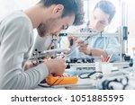engineering students working in ... | Shutterstock . vector #1051885595