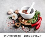 pepper in white mortar and... | Shutterstock . vector #1051934624