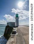 green lighthouse on the little... | Shutterstock . vector #1051944659