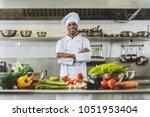 handsome african american chef... | Shutterstock . vector #1051953404