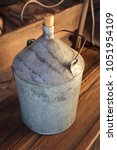Small photo of A can of galvanized tin under kerosene. Brazed with handle and cork.
