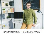 handsome man standing by table... | Shutterstock . vector #1051987937