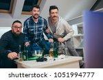 group of friends watching sport ... | Shutterstock . vector #1051994777