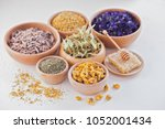 bowls full of different herbs... | Shutterstock . vector #1052001434
