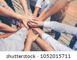people putting their hands... | Shutterstock . vector #1052015711