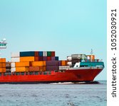 red container ship. logistics...   Shutterstock . vector #1052030921