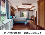 bedroom in blue colours with... | Shutterstock . vector #1052035175