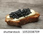 sandwich with black caviar on... | Shutterstock . vector #1052038709