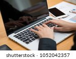 business people using laptop... | Shutterstock . vector #1052042357
