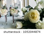 champagne flutes with little... | Shutterstock . vector #1052044874