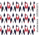 ikat seamless pattern  as cloth ... | Shutterstock . vector #1052061071