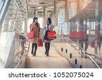 two friends walking on the city ... | Shutterstock . vector #1052075024