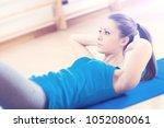 attractive woman doing abs...   Shutterstock . vector #1052080061