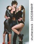 women in bodysuits hug bearded... | Shutterstock . vector #1052084849