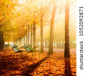 park in autumn | Shutterstock . vector #1052092871