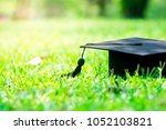 graduation cap in graden  ... | Shutterstock . vector #1052103821