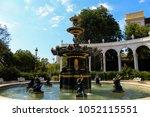beautiful fountain in a park... | Shutterstock . vector #1052115551