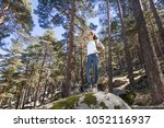 hiker sport woman standing on... | Shutterstock . vector #1052116937