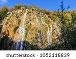 lower view of waterfalls in... | Shutterstock . vector #1052118839