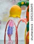 shower in the water park | Shutterstock . vector #1052130695