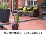 veranda in park hotel and... | Shutterstock . vector #1052138381