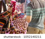 Small photo of A man, tourist, negotiating the price of hill tribe souvenirs in Chiang Mai, Thailand - bargaining skill