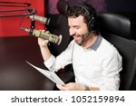 smiling young male radio... | Shutterstock . vector #1052159894