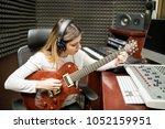 female musician playing guitar... | Shutterstock . vector #1052159951