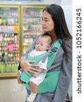 young business woman choosing... | Shutterstock . vector #1052166245