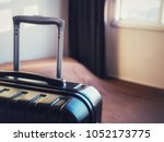 the black suitcase is in an... | Shutterstock . vector #1052173775