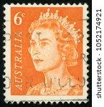 Small photo of AUSTRALIA - CIRCA 1970: post stamp printed in Australia shows portrait of Queen Elizabeth II; Scott 401 6c orange; circa 1970