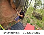 female climber with boulder... | Shutterstock . vector #1052179289