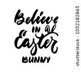 believe in easter bunny   hand... | Shutterstock .eps vector #1052182865