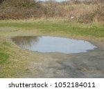puddle in a park  | Shutterstock . vector #1052184011