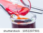 close up hand with glove pour... | Shutterstock . vector #1052207501