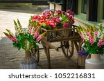 Wheelbarrow With Flowers On A...