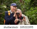 Senior Man Helps Wife Look...