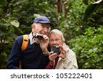 Two Seniors With Camera And...