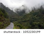road that disappears in the... | Shutterstock . vector #1052230199