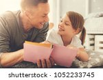 father and daughter. delighted... | Shutterstock . vector #1052233745