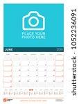 june 2019. wall calendar for... | Shutterstock .eps vector #1052236091