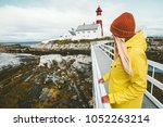 woman sightseeing norway... | Shutterstock . vector #1052263214