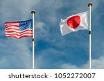 An American And Japan Flags Ar...