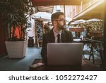 young diffident bearded... | Shutterstock . vector #1052272427
