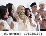 group of men and women smiling... | Shutterstock . vector #1052301971
