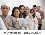 group of muslim asian men and... | Shutterstock . vector #1052302007