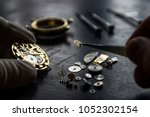 watchmaker is repairing the... | Shutterstock . vector #1052302154