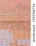 Small photo of The wall of bricks is unglued dirty orange. Beautiful background of smooth masonry. Texture.