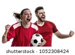 young couple fan in red uniform ... | Shutterstock . vector #1052308424